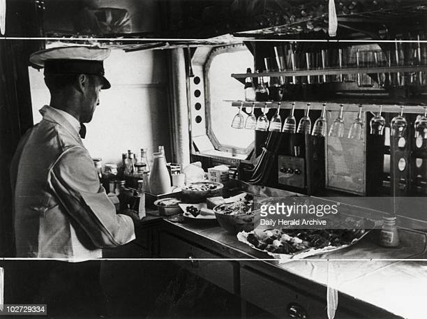 Preparing lunch on the Imperial Airways aeroplane 'Scylla' 19 November 1936 Photograph by James Jarche showing the galley on the Imperial Airways...
