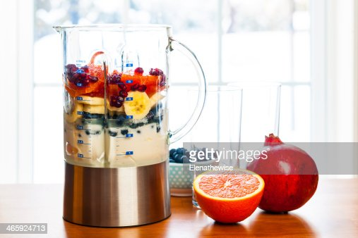 Preparing smoothies with fruit and yogurt : Stock Photo