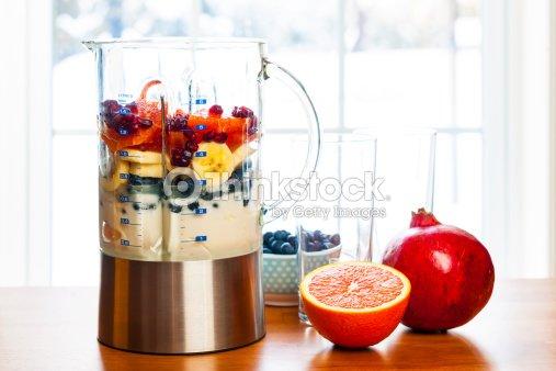 Preparing smoothies with fruit and yogurt : Stock Photo