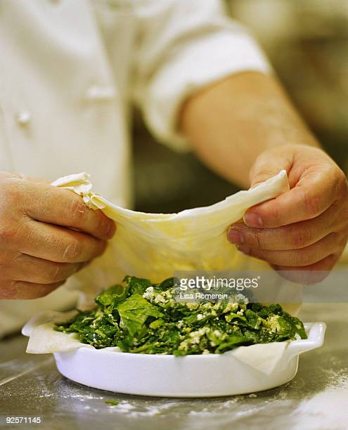 Preparing spanakopita pie