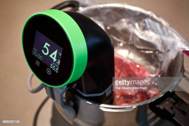 WASHINGTON DC Preparing steak for the Nomiku home sous vide the Nomiku comes up to it's constant temperature photographed in Washington DC