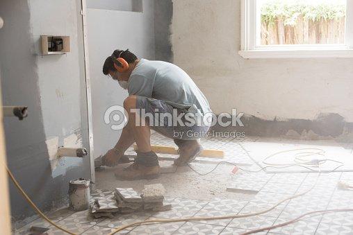 Preparing The Bathroom Floor For Tiling Stock Photo | Thinkstock on building a bathroom floor, tiling a bathtub, waterproofing a bathroom floor, penny round tile bathroom floor, luxury vinyl tile bathroom floor, white subway tile bathroom floor, ceramic tile bathroom floor, remodeling a bathroom floor, framing a bathroom floor, tiling a sink, heating a bathroom floor, painting a bathroom floor, tile a bathroom floor, tiling a vanity, re-tiling bathroom floor, carpet a bathroom floor,