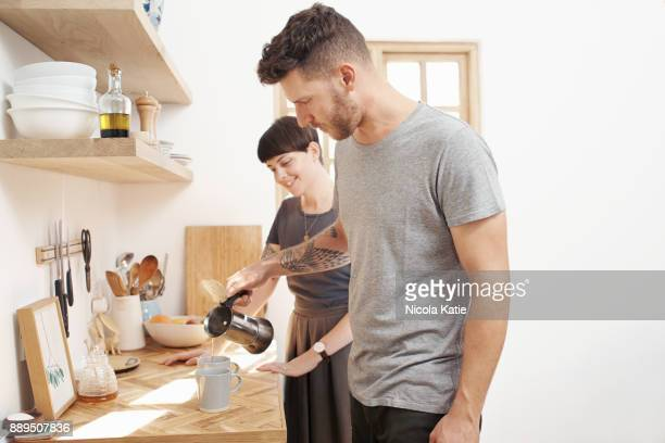 Preparing their morning coffee