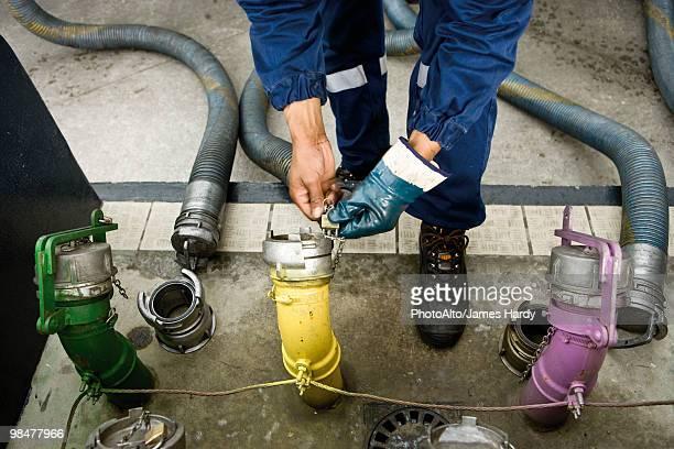 Preparing to fill gas station fuel storage tanks