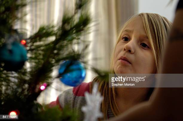 Preparing to welcome her stepfather US Army Sgt Joseph Peoples home from a 15 month deployment to Iraq Taylor Knapp places Christmas ornaments on the...