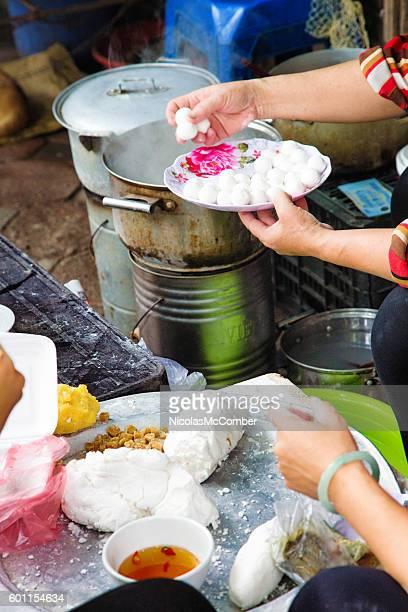Preparing Vietnamese Banh Troi on the streets of Hanoi