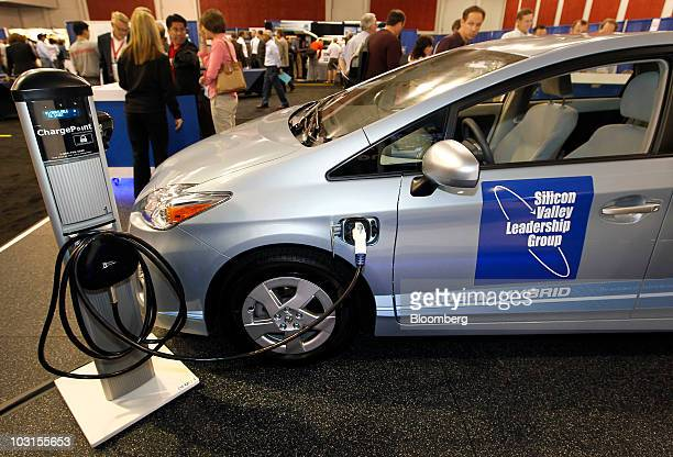 A preproduction model of Toyota Motor Corp's Prius PlugIn Hybrid is connected to a charging port at the PlugIn 2010 electric car conferfence in San...