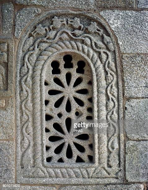 PreRomanesque Art Spain Galicia Church of San Gines in Francelos Built ca 900 Facade Detail with a window decorated with ornate stone shed