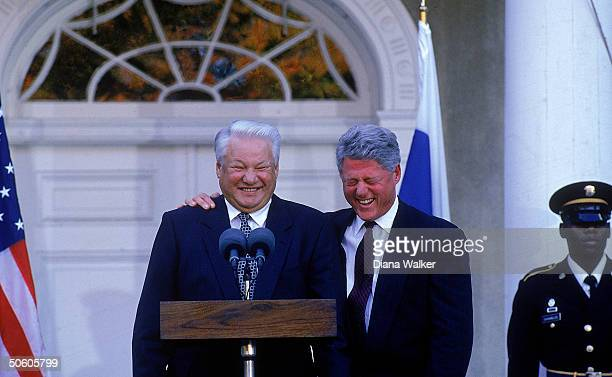 Pres Bill Clinton bantering w Boris Yeltsin at mikes in summit briefing during Russian Pres's visit for UN 50th anniv fete at FDR's estate