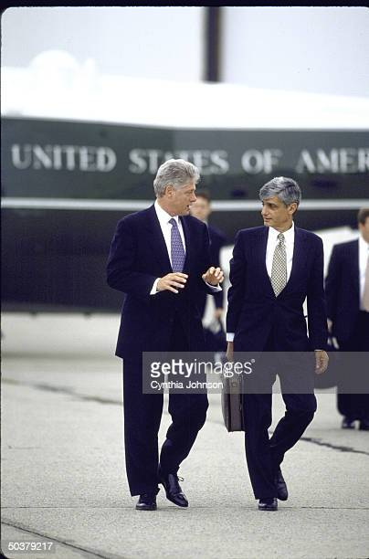 Pres Bill Clinton chatting w Treasury Secy Robert Rubin while walking from Marine One copter to Air Force One departing JFK Airport