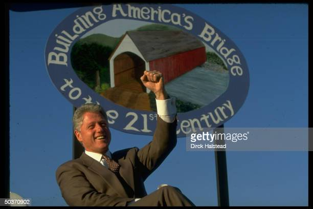 Pres Bill Clinton confidently raising fist at election campaign rally