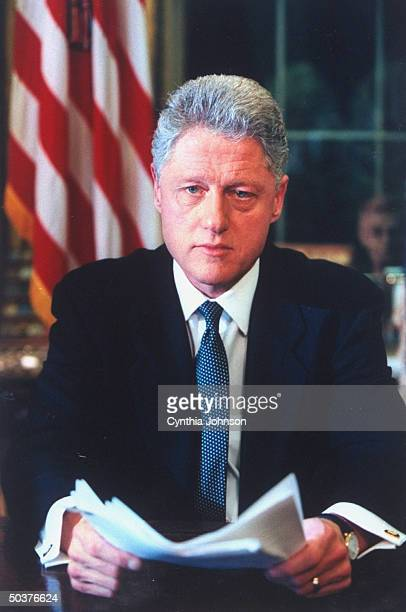 Pres Bill Clinton in serious portrait just before delivering televised speech to nation announcing air strikes against Iraq for refusing to cooperate...