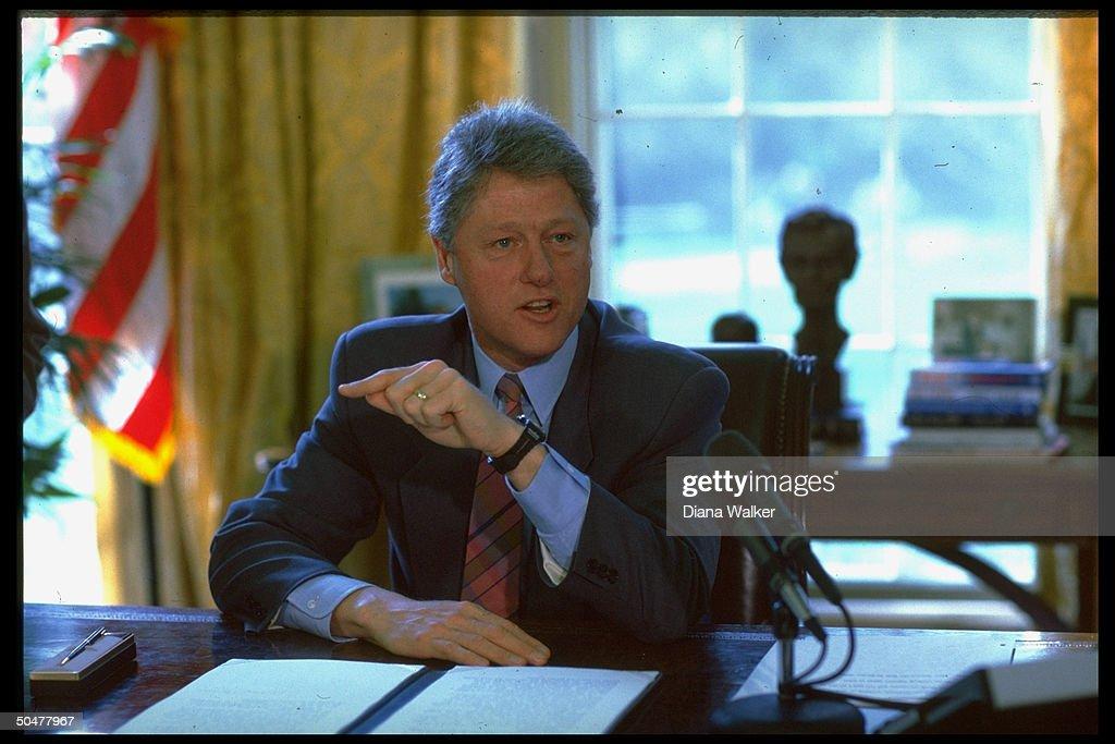 bill clinton sitting at his oval office desk during immunization bill signing bill clinton oval office