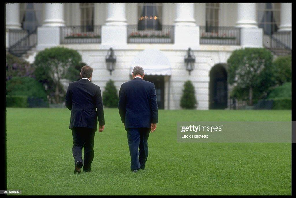 Pres Bill Clinton VP Al Gore walking back towards WH after lawn ceremony honoring OP Restore Hope vets returning home fr Somalia