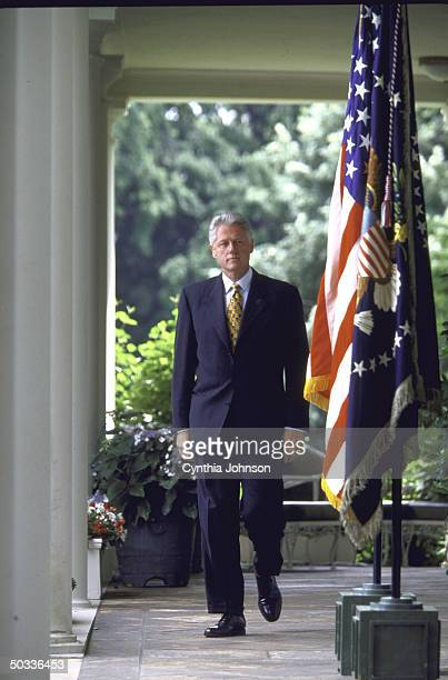 Pres Bill Clinton walking White House colonnade in full length portrait