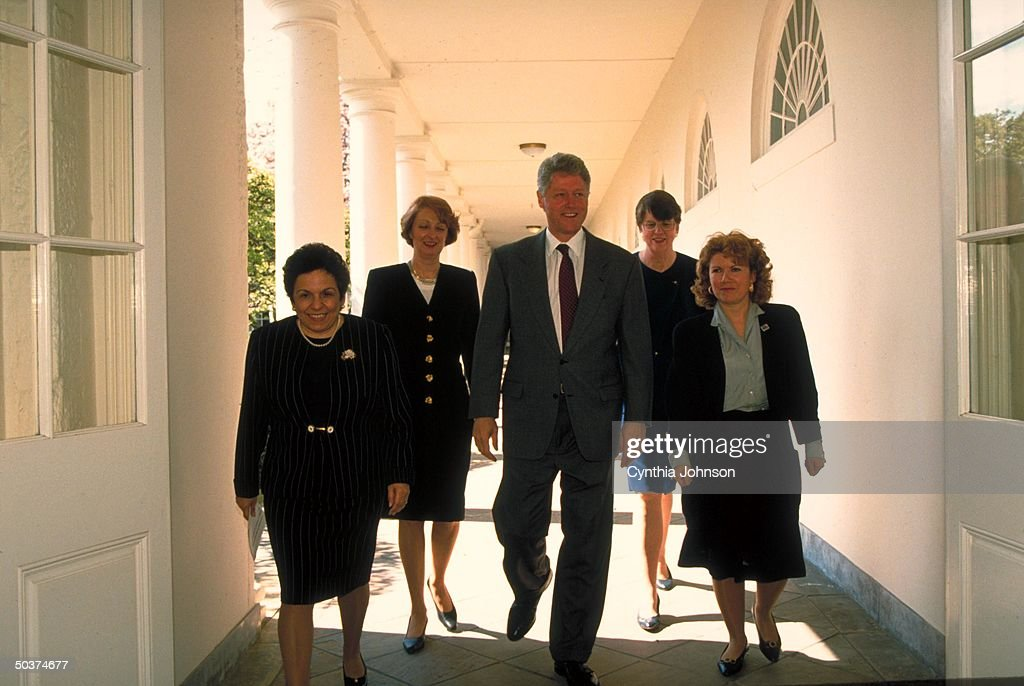 Pres. Bill Clinton (C) walking White House colonnade to East Room w. (L-R) HHS Secy. Donna Shalala, Violence Against Women office dir. Bonnie Campbell, Attorney Gen. Janet Reno & Suffolk County Domestic Violence office dir. Sarah Buel.