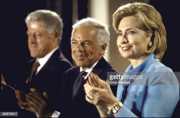 Pres Bill Hillary Rodham Clinton flanking Ralph Lauren during ceremony at Smithsonian announcign fashion designer's gift funding restoration of...