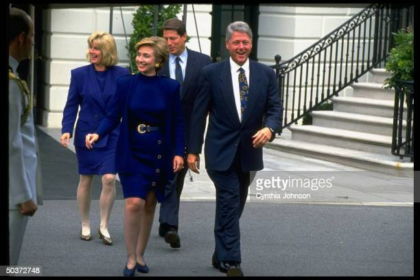 Pres Bill Hillary Rodham Clinton striding confidently VP Al Tipper Gore in tow outside White House