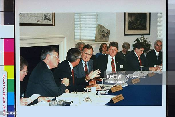 Pres Bush during his education summit seated at table of Gov's talking w Gov Garrey Carruthers w WH chief of staff John Sununu