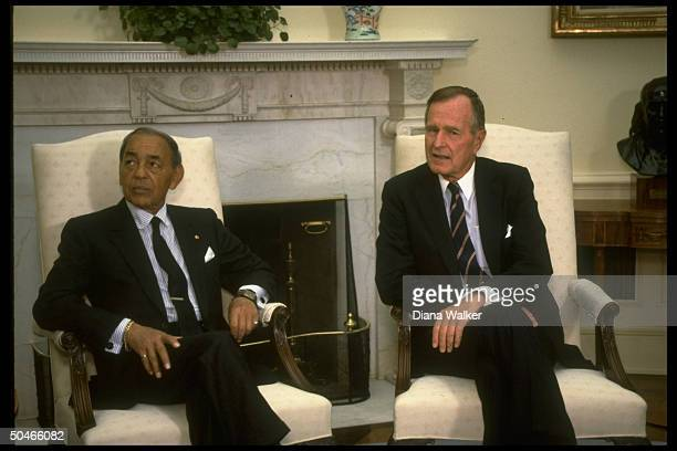 Pres Bush mtg w King Hassan of Morocco sitting by Swedish ivytopped WH Oval Office mantelpiece