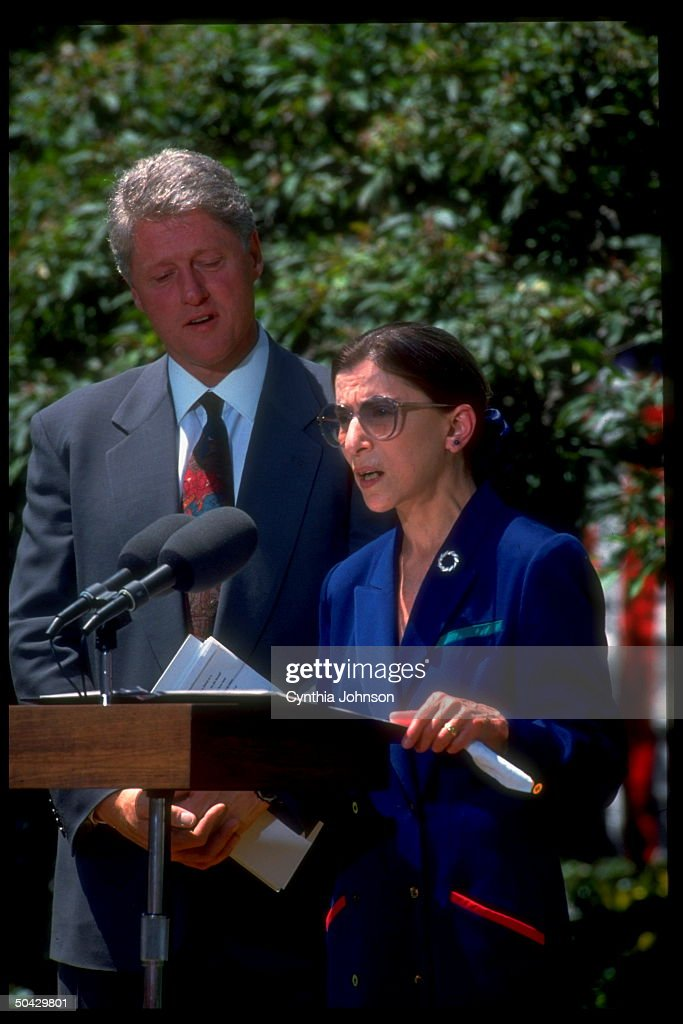 Pres Clinton listening to Judge Ruth Bader Ginsburg accept nomination as Supreme Court Justice in WH Rose Garden