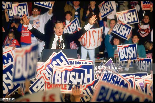 Pres George Bush delivering speech in last day multistate campaign swing appearance framed by enthused crowd