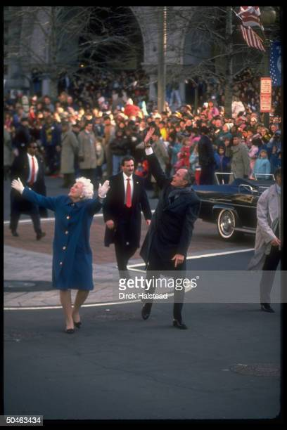 Pres George Bush First Lady Barbara Bush waving to enthusiastic crowd lining Pennsylvania Avenue during Inaugural parade