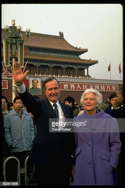 US Pres George Bush wife Barbara waving to crowd in Tiananmen Square