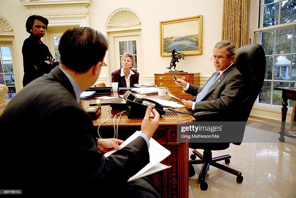 Pres George W Bush preparing for his evening address to Congress and the nation w Director of Presidental Speechwriting Mike Gerson Counselor to the...