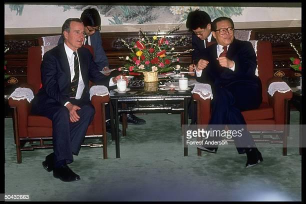 Pres Jiang Zemin mtg w former US Pres Bush framed by interpreters