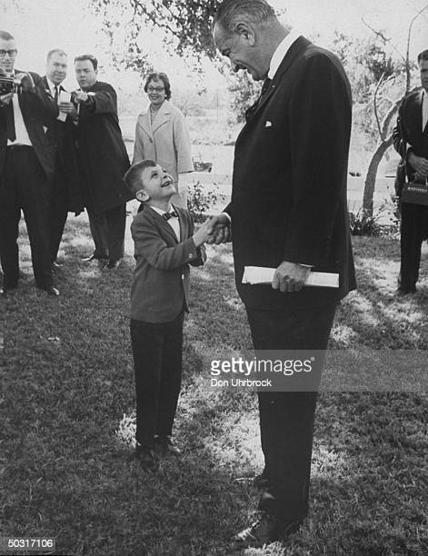 Pres Lyndon B Johnson shaking hands with Richard Barnes poster boy for the National Assn of Retarded Children