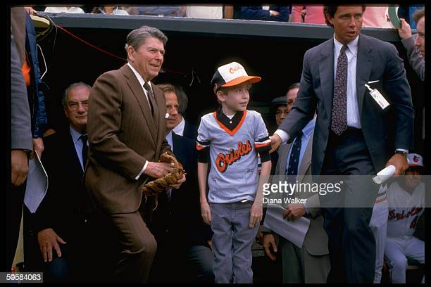 Pres Reagan by dugout at Baltimore Orioles game w secret service 12yrold cystic fibrosis victim Brian Gray Ueberroth Williams1986