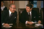 Pres Reagan sharing lighthearted moment w House Spkr Jim Wright during WH mtg w congressional ldrship re summit