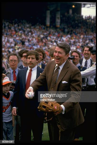 Pres Reagan w glove ball opening Baltimore Orioles game w secret service 12yrold cystic fibrosis victim Brian Gray et al1986