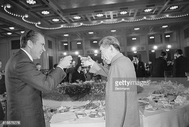 Pres Richard Nixon and Chinese Premier Chou Enlai toast each other during banquet hosted by the visiting Americans here Feb 25