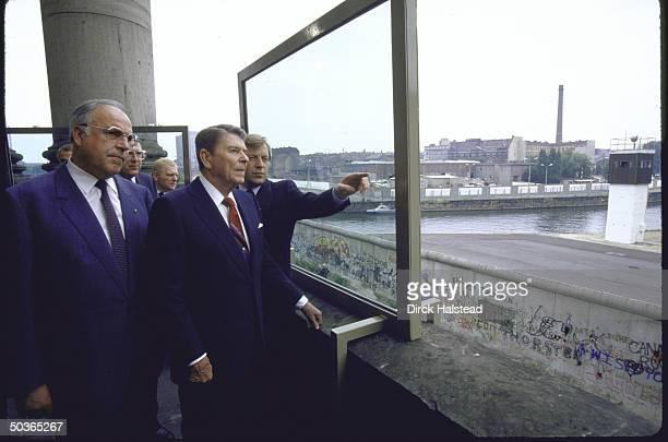 US Pres Ronald W Reagan and West German Chancellor Helmut Kohl viewing the Berlin Wall from balcony of the Reichstag