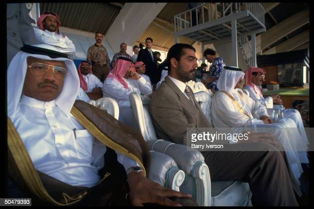Pres Saddam 's son Udai in VIP stand during soccer match pitting Iraq Qatar