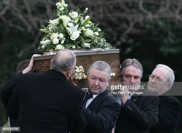 Presbyterian cleric the Rev Roy Magee's coffin is carried for burial in Dundonald on the outskirts of Belfast
