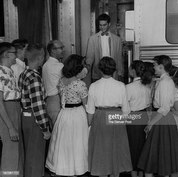 AUG 12 1955 Presbyterians Andrew Sammoury of Lebanon smiles happily as he is welcomed to Colorado by 15 members of Northeastern Colorado Presbyterian...
