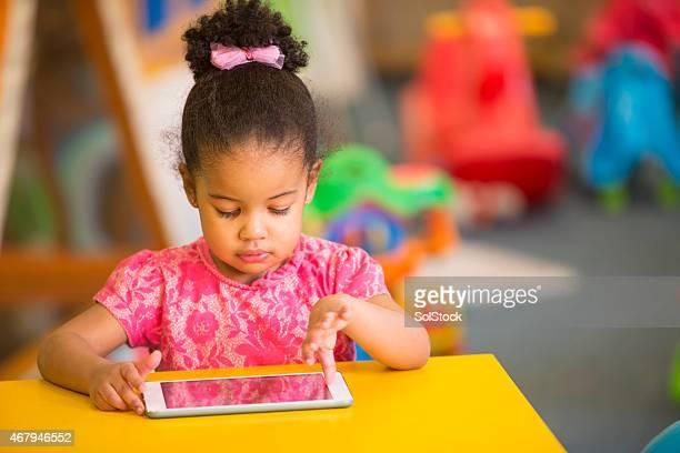 Preschool Child using Digital Tablet