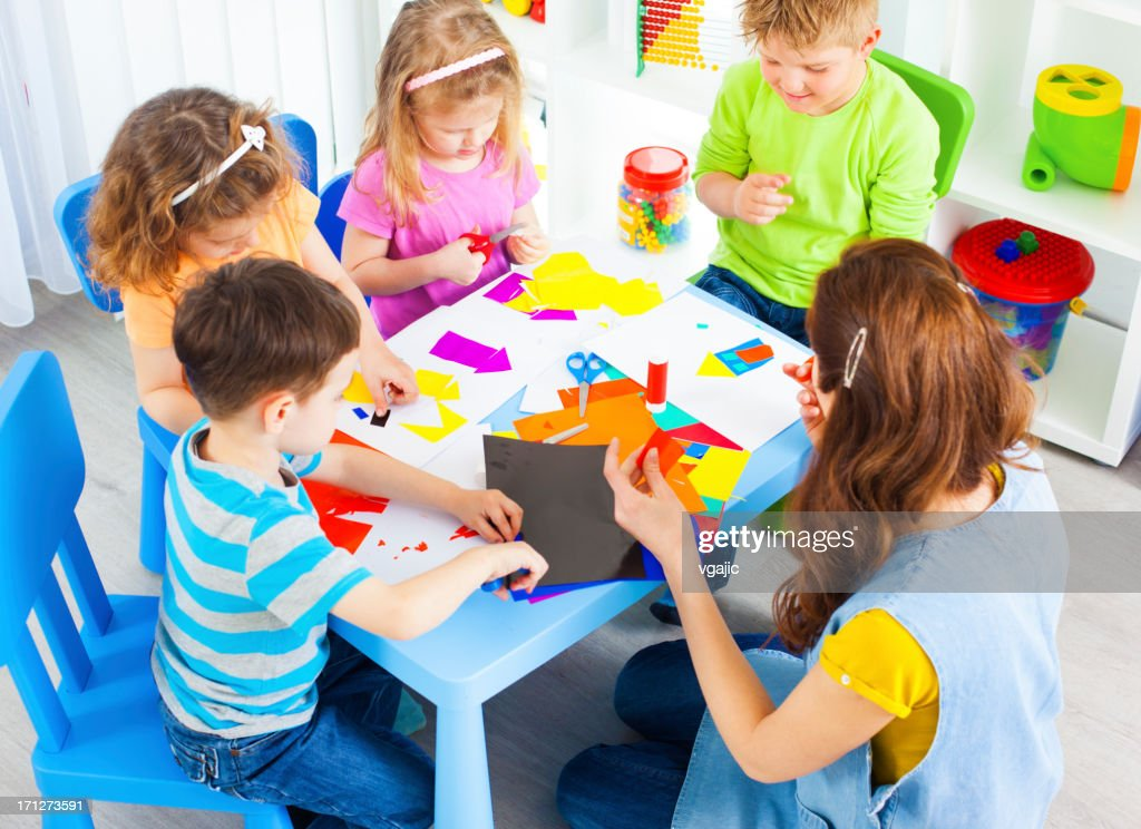 preschool children craft activities with color paper and glue stock photo