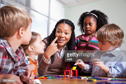 Preschool children in classroom with teacher