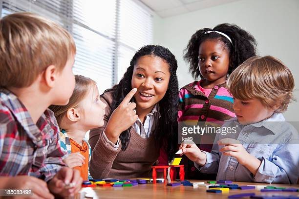 Preschool children in classroom with teacher