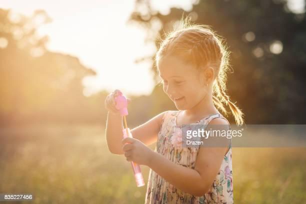 Preschool girl playing in park