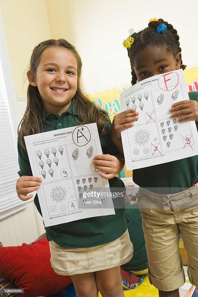 Preschool girls with A plus and F on Math : Stock Photo