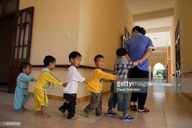 Preschool handicapped children play games at the Thanh Tam Special school March 6 Danang Vietnam where Vietnamese students with disabilities can...