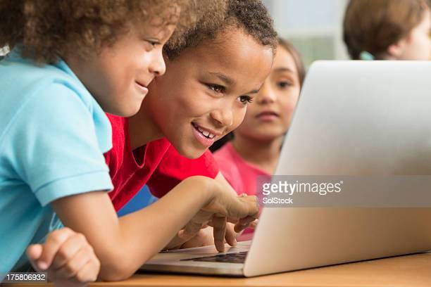 Preschool Learners Using A Laptop