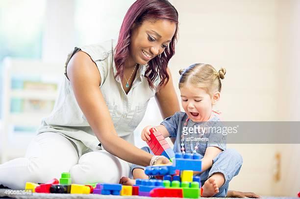 Preschool Teacher with Little Girl
