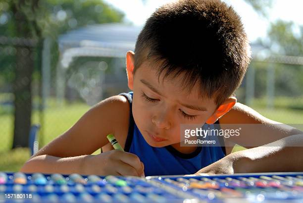 preschooler drawing a picture outdoors