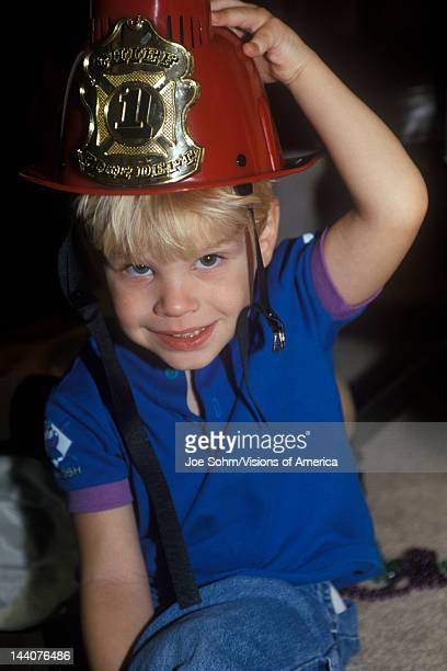 Preschooler playing dress up with Firemans' hat on Washington DC